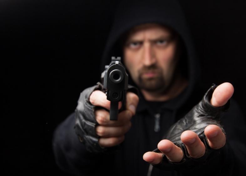 12153941-man-holding-gun-demanding-money